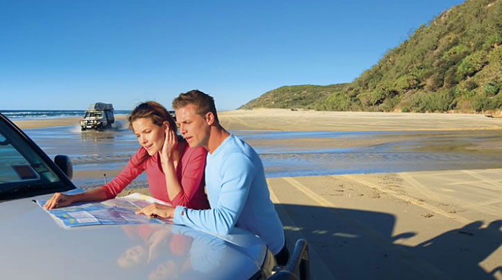 Couple on Fraser Island Beach with 4WD